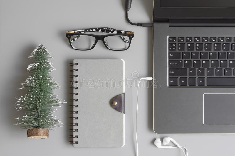 Merry Christmas and Happy new years office work space desktop co. Ncept. Flat lay top view with blank space notebook copy space for your text stock photo