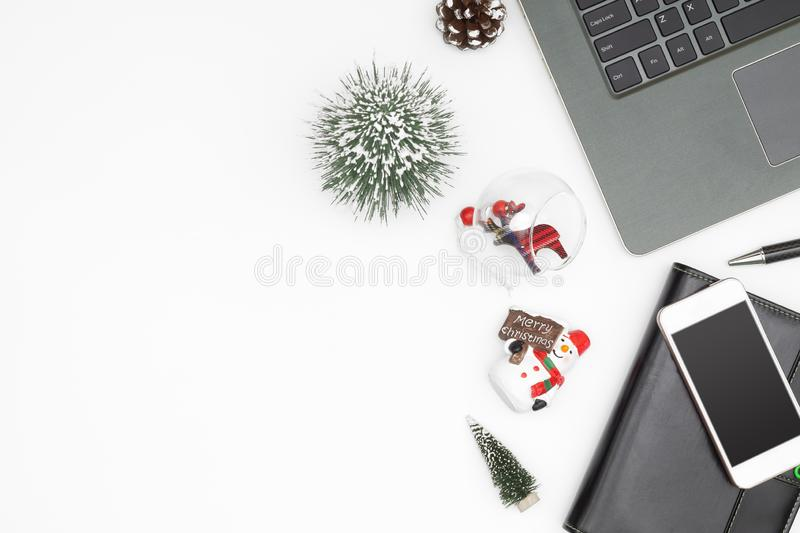 Merry Christmas and Happy new years office work space desktop co. Ncept. Flat lay top view with laptop notebook and Christmas ornaments with copy space royalty free stock photo