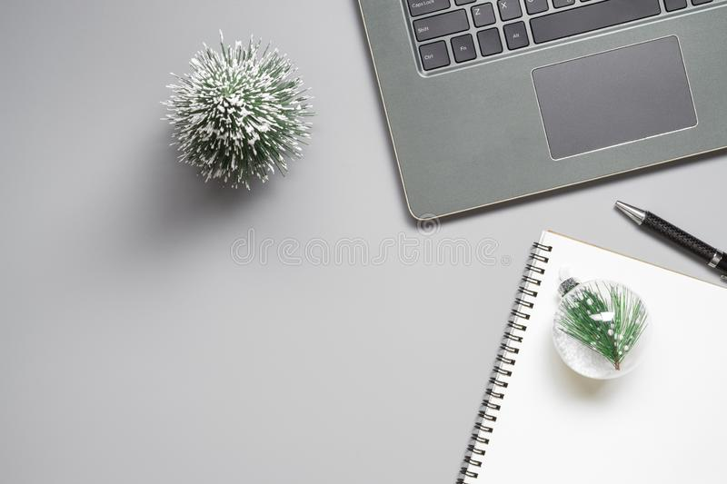 Merry Christmas and Happy new years office work space desktop co. Ncept. Flat lay top view with laptop notebook and Christmas ornaments with copy space stock photography