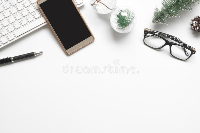 Merry Christmas and Happy new years office work space desktop co. Ncept. Flat lay top view with laptop notebook, smartphone, glasses and Christmas ornaments with stock image