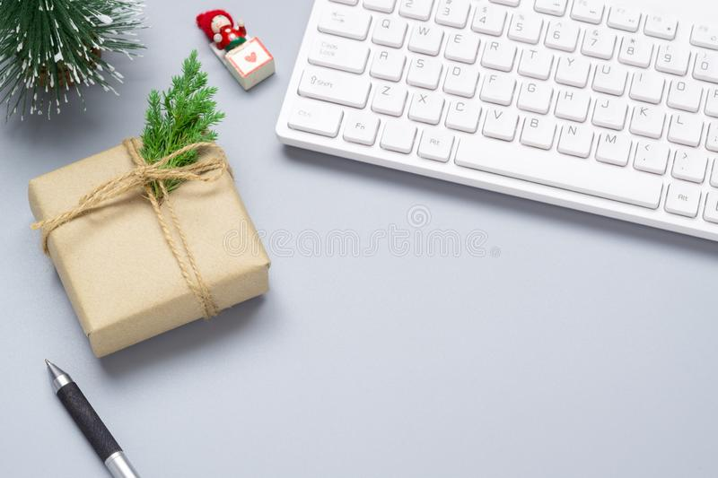 Merry Christmas and Happy new years office work space desktop concept. Flat lay top view with keyboard, natural gift box and. Christmas ornaments with copy stock photos
