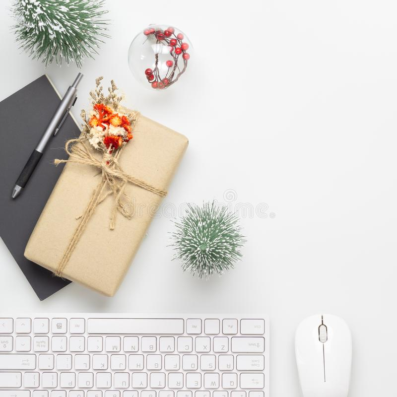 Merry Christmas and Happy new years office work space desktop concept. Flat lay top view with laptop, notebook and Christmas. Ornaments with copy space stock image