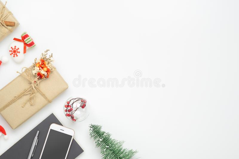 Merry Christmas and Happy new years office work space desktop concept. Flat lay top view with  smartphone, notebook and Christmas royalty free stock photos