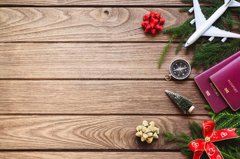 Merry Christmas and Happy new years travel concept background for winter trip on wood background , Travel with airplane top view. With copy space stock photography