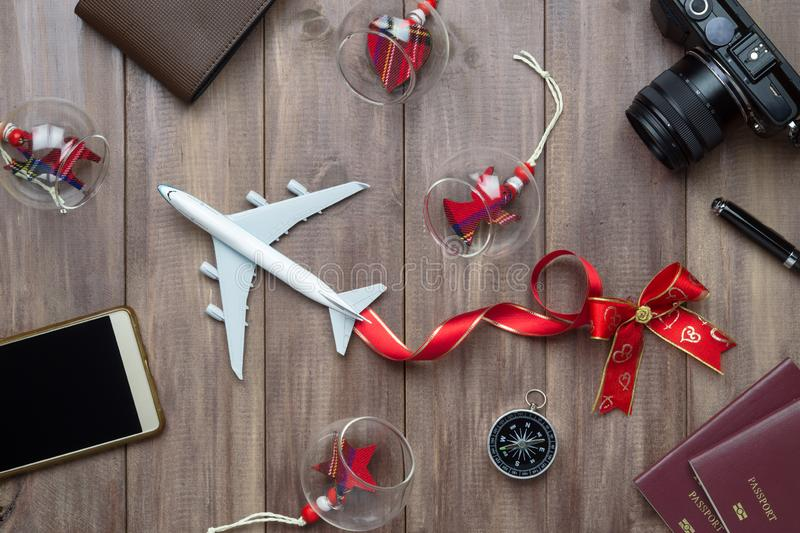 Merry Christmas and Happy new years travel concept background for winter trip on wood background , Travel with airplane top view. With copy space royalty free stock images