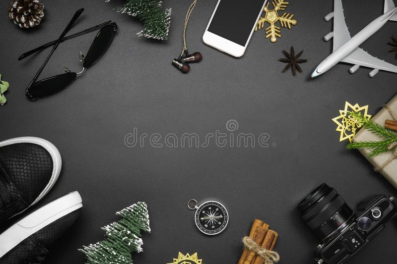 Merry Christmas and Happy new years travel concept background for winter trip on wood background , Travel with airplane top view. With copy space royalty free stock photo