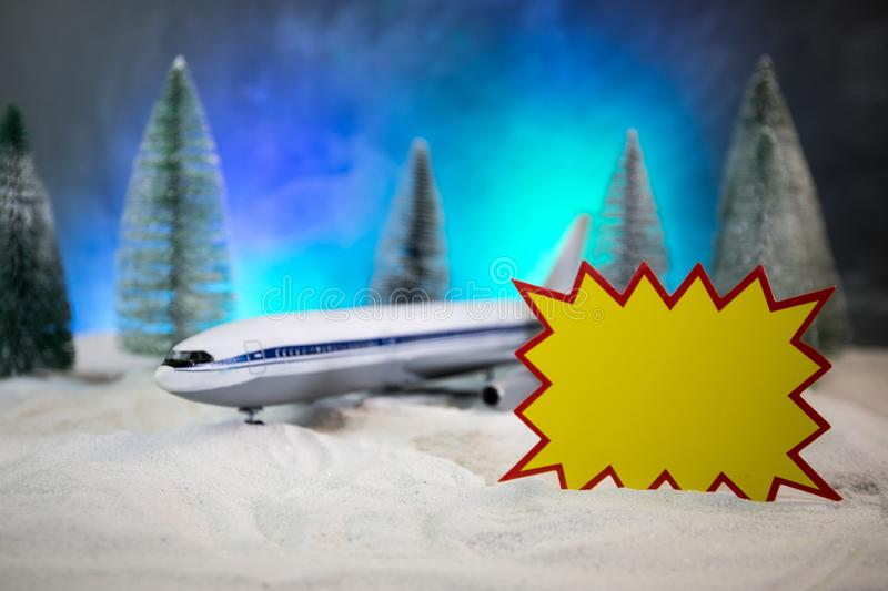 Merry Christmas and Happy new years travel concept background for winter trip on wood background , Travel with airplane top view stock photography