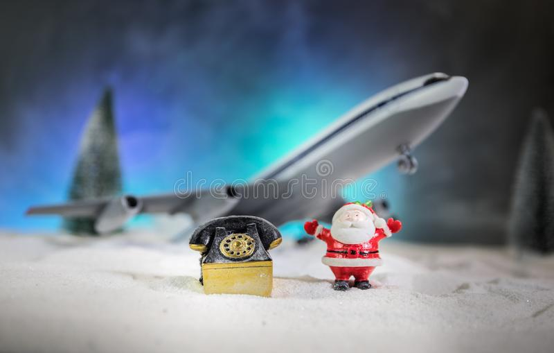 Merry Christmas and Happy new years travel concept background for winter trip on wood background , Travel with airplane top view royalty free stock photo