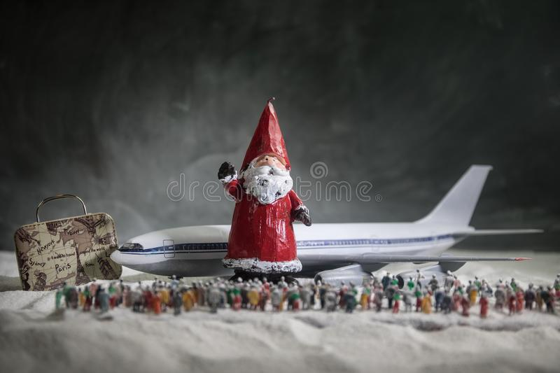 Merry Christmas and Happy new years travel concept background for winter trip on wood background , Travel with airplane top view stock photo