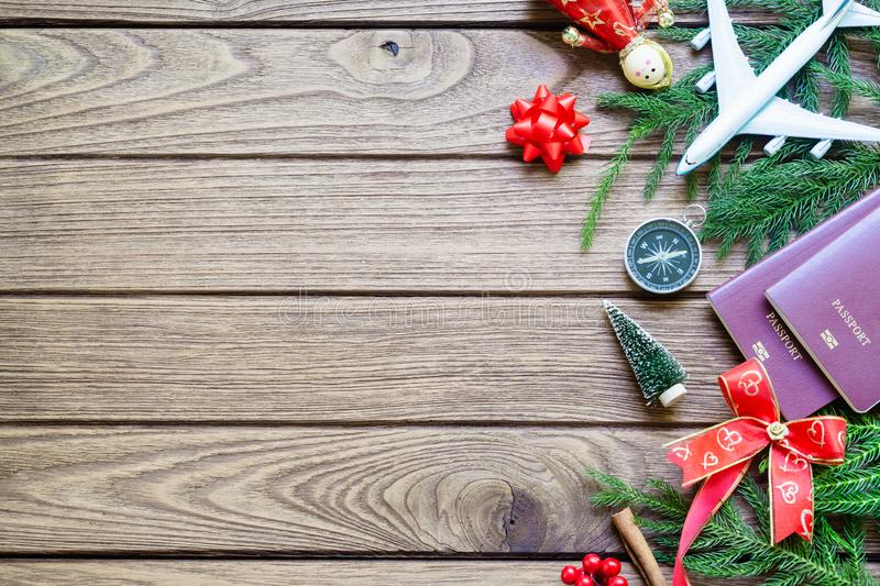 Merry Christmas and Happy new years travel concept background for winter trip on wood background , Travel with airplane top view. With copy space royalty free stock photos