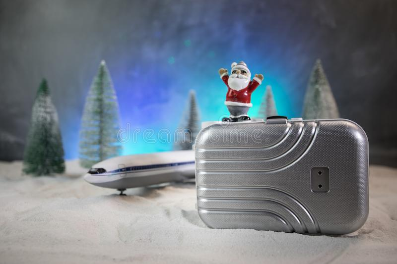 Merry Christmas and Happy new years travel concept background for winter trip on wood background , Travel with airplane top view royalty free stock photos