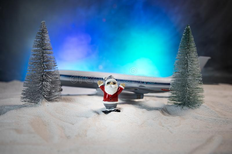 Merry Christmas and Happy new years travel concept background for winter trip on wood background , Travel with airplane top view. Merry Christmas and Happy new stock image