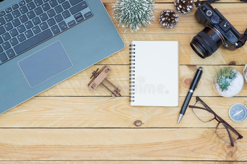 Merry Christmas and Happy new years travel planning concept background for winter trip on wood background , Travel with airplane. Top view with copy space royalty free stock image