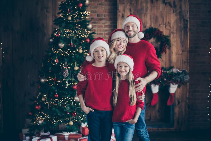 Merry christmas and happy newyear.Photo of daddy mommy sister brother having best x-mas eve together near garland tree royalty free stock photography