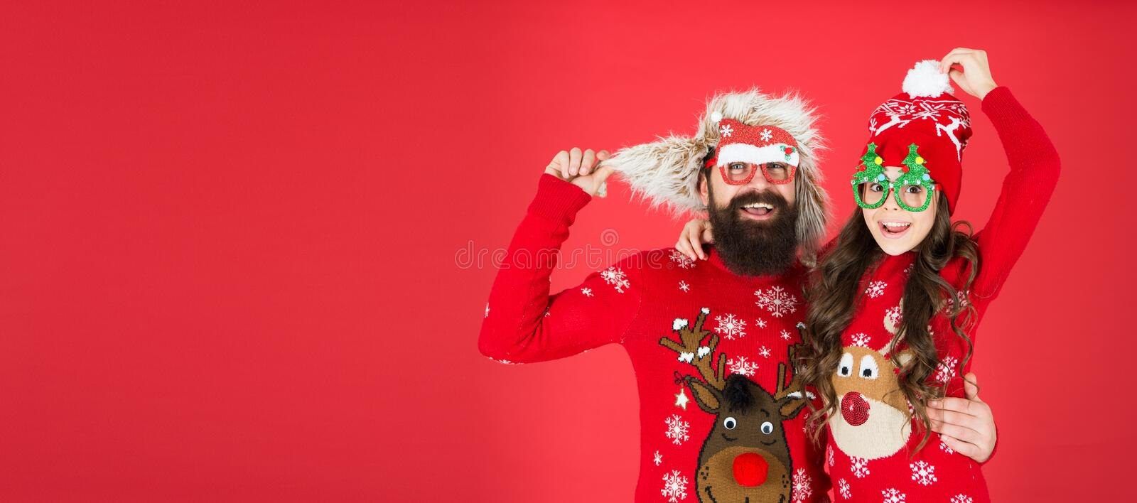 Merry christmas. kid and santa man on party. love and joy. father and daughter celebrate xmas. little girl with dad red royalty free stock photos