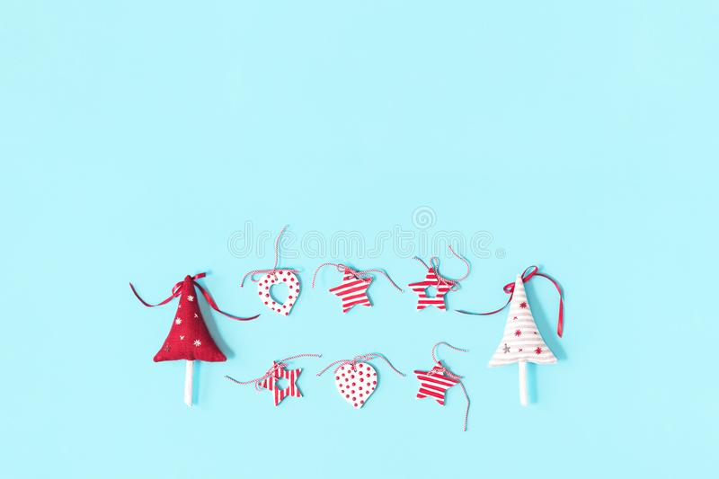 Merry Christmas layout of handmade toys garland on blue royalty free stock photos