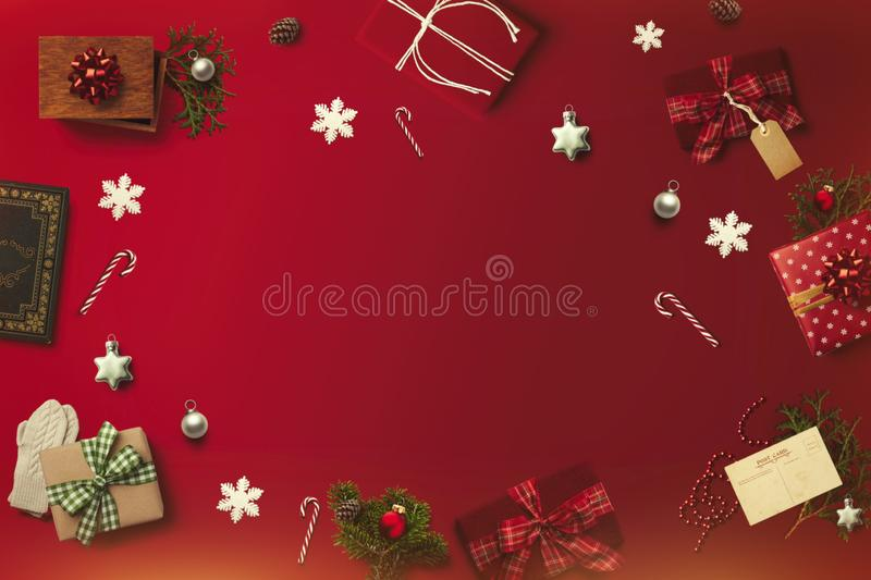 Merry Christmas layout on the red background. Gifts, presents, postcard, canes stock photo