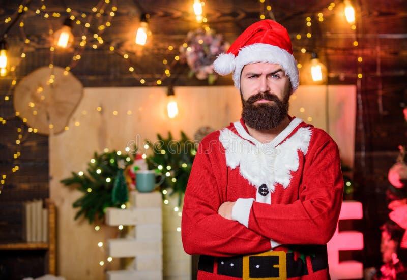 Merry christmas. man santa hat. sad bearded man elf. new year gifts. christmas decoration. winter holidays. wait for. Xmas presents. serious santa claus. winter stock photography