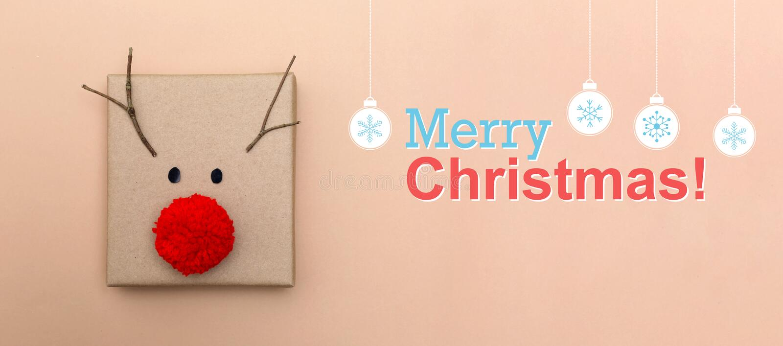 Merry christmas message with a reindeer gift box stock photo