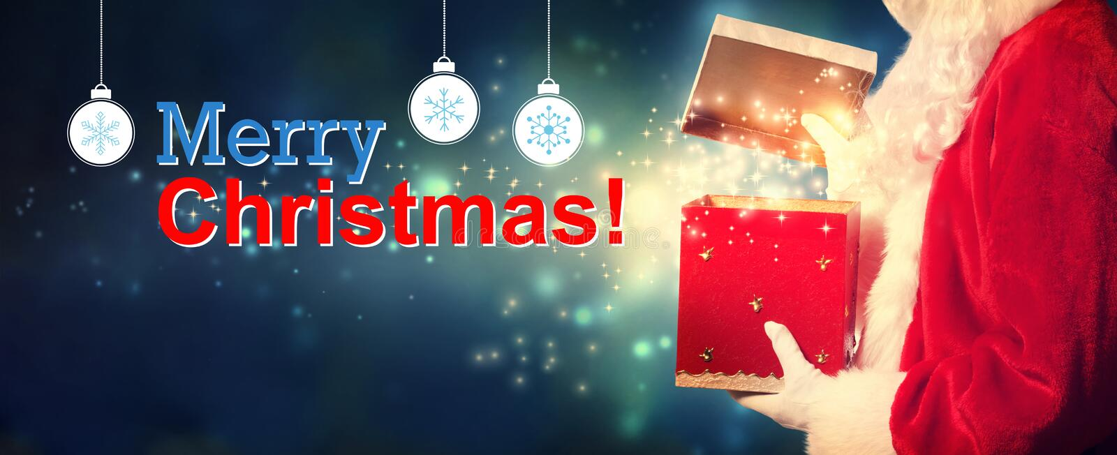 Merry Christmas message with Santa opening a gift box stock images