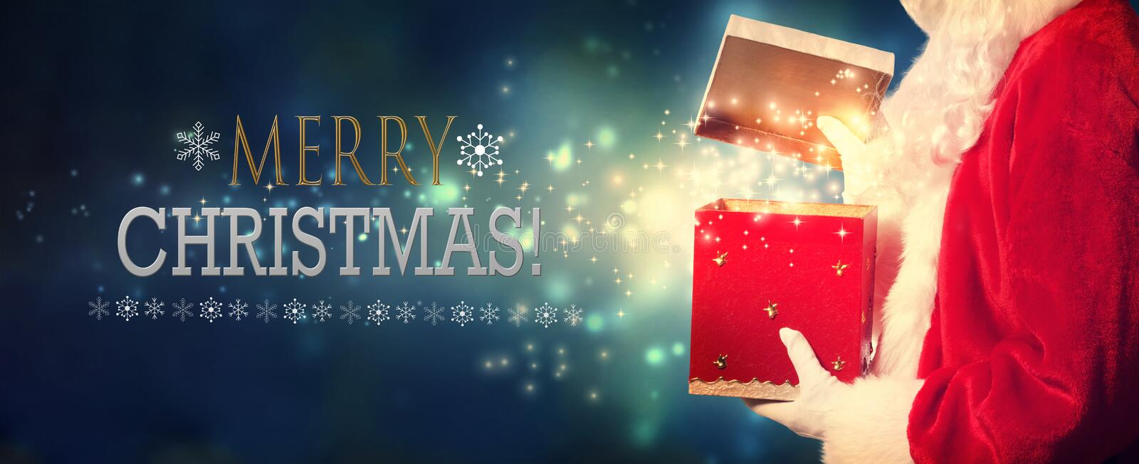 Merry Christmas message with Santa opening a gift box stock photos