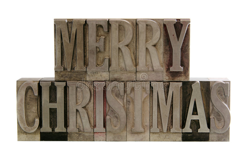 Merry christmas in metal type. The phrase 'merry christmas' in letterpress metal letters isolated on white royalty free stock photos