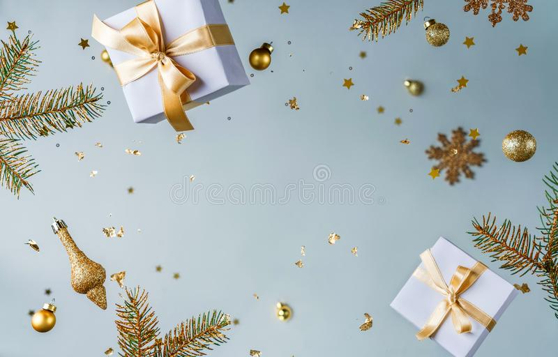 Merry Christmas and New Year background. Xmas holiday card made of flying decorations, gold fir branches, balls, snowflakes stock image