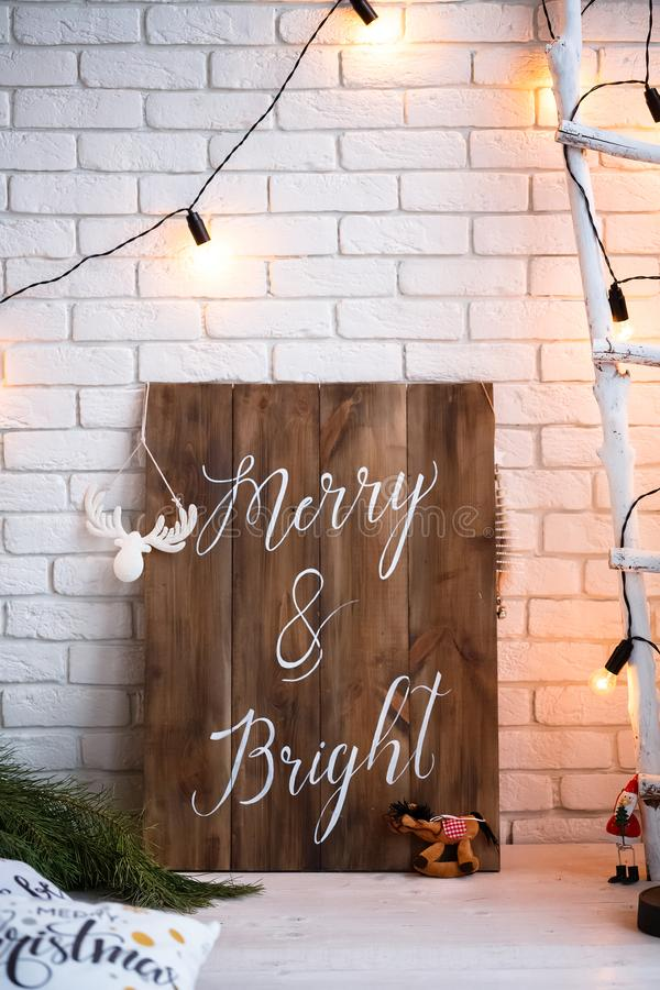 Merry christmas and new year brick wall background. white decor. Loft style. Merry christmas and new year brick wall background. white decor. Loft style royalty free stock photography