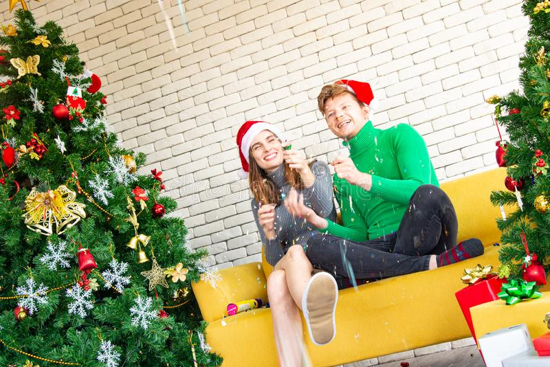 Merry Christmas and New Year concept. Young Caucasian lover with christmas theme clothing celebrate and exchange presents stock photography