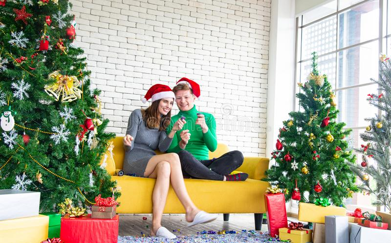 Merry Christmas and New Year concept. Young Caucasian lover with christmas theme clothing celebrate and exchange presents stock photos