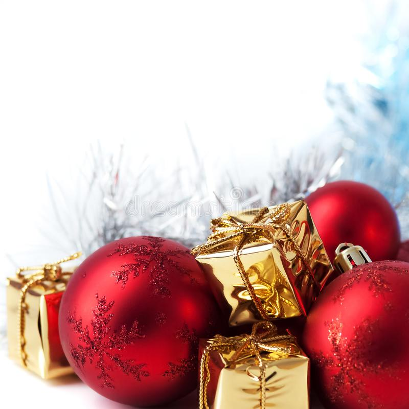 Merry Christmas, New Year, gifts in gold boxes, red Christmas balls in the right corner. White background.  stock image