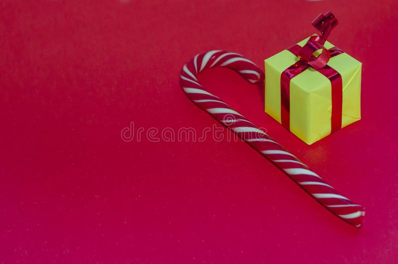 Merry Christmas, New Year, holidays. New Year, holidays, celebration concept. giving gifts wrapped in colorful paper on red background. Christmas tree gifts royalty free stock photo
