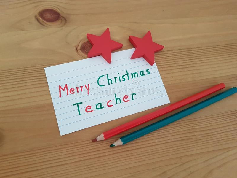 Merry Christmas Note To Teacher With Colored Pencils And Stars royalty free stock images