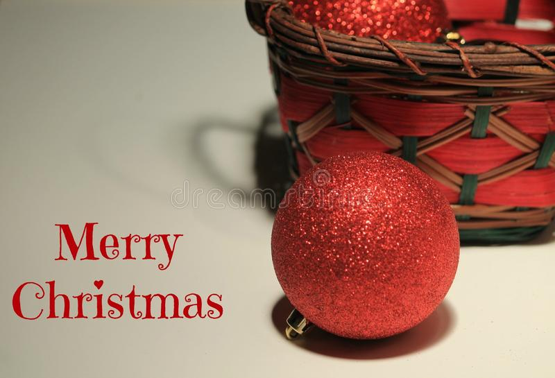 Merry Christmas. Christmas ornaments and basket, with the words, Merry Christmas stock image