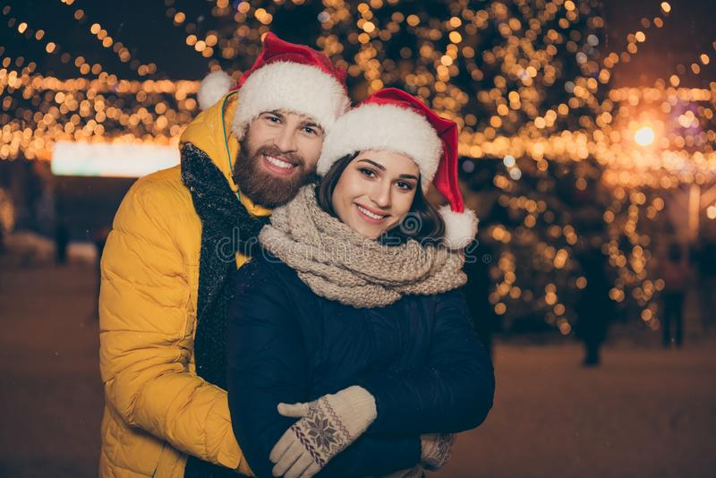 Merry christmas. Photo of two people guy lady visit city illuminated park x-mas evening frosty weather stand piggyback royalty free stock images