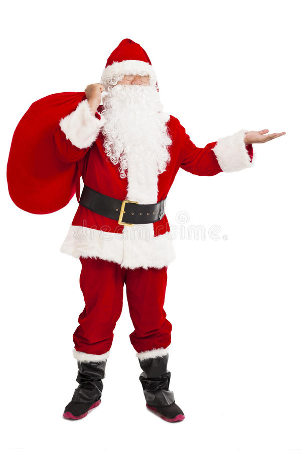 Merry Christmas Santa Claus holding gift bag and showing. Over white background royalty free stock images