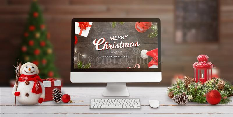 Merry Christmas scene with computer display on work desk stock images