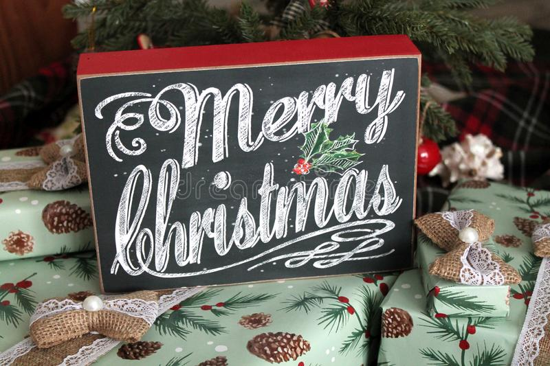 Merry Christmas Sign on Gifts. A Merry Christmas sign on top of a bunch of wrapped gifts royalty free stock photos