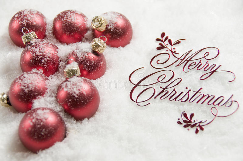 Merry Christmas Sign and Ornaments in Snow. Merry Christmas Sign and Baubles in Snow stock images
