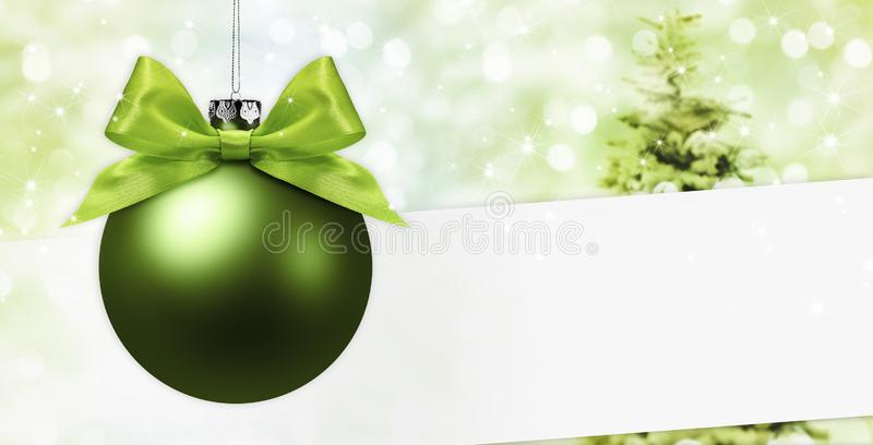Merry christmas signboard or gift card, ball with green ribbon b. Ow on blurred green xmas lights and tree, copy space blank background stock photos