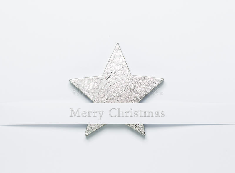 Merry Christmas silver star. Silver star on a white background. Christmas decoration, Christmas card, for writing holiday greetings stock photo
