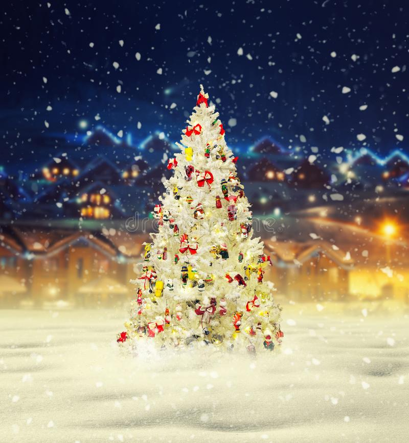 Merry christmas, snowy xmas tree with decoration stock photo