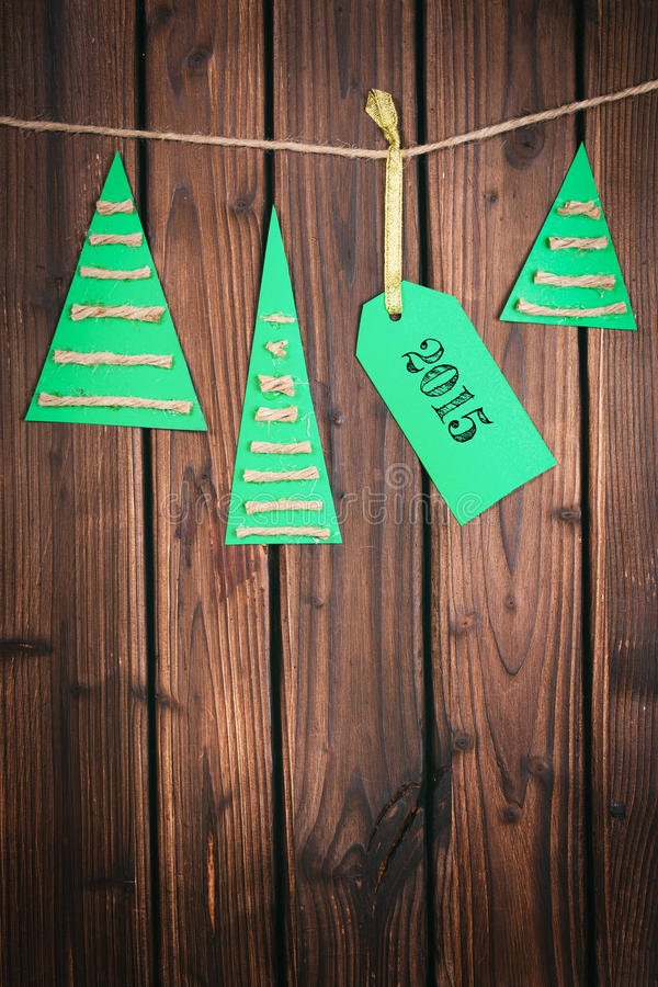 Merry Christmas tag on wooden surface. Merry Christmas tag on wooden background royalty free stock photo