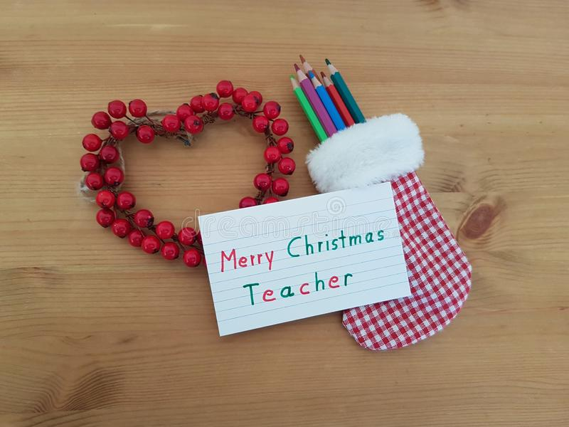 Merry Christmas Note To Teacher With A Christmas Stocking, Colored Pencils And Wreath royalty free stock photography