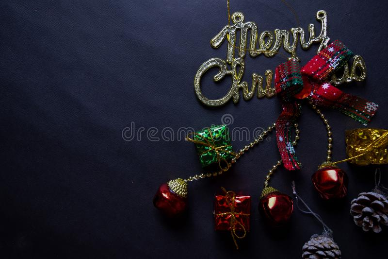 Merry christmas text and Decorative Christmas isolated on black background stock photography