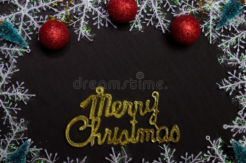 Merry christmas text and Decorative Christmas isolated on black background stock photo