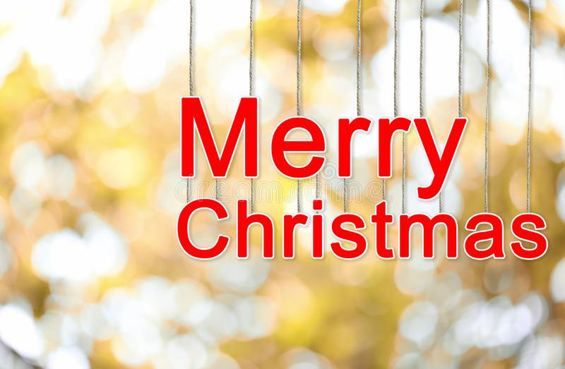 Merry Christmas text on gold bokeh background stock images