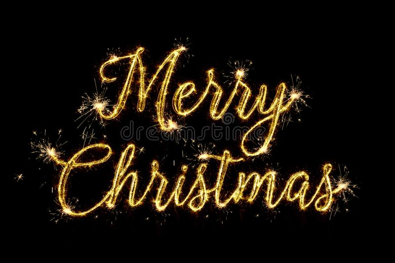 Merry Christmas of 2020. Text Merry Christmas written sparkling sparklers fireworks isolated on black background. Overlay template royalty free stock photos