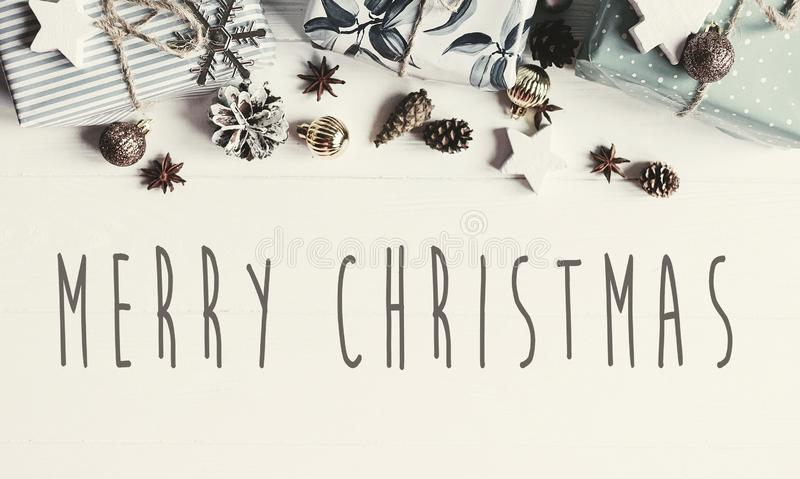 Merry Christmas text on modern christmas flat lay with ornaments royalty free stock image
