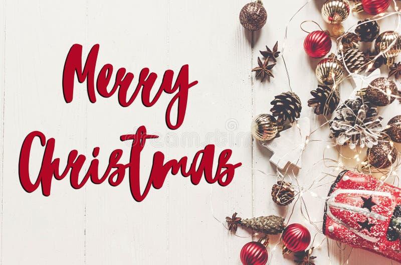 Merry christmas text, seasonal greetings card sign. flat lay. mo royalty free stock photo